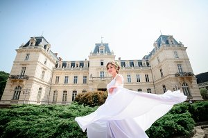 Bride in white dress walks