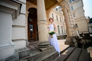 Bride standing near manor