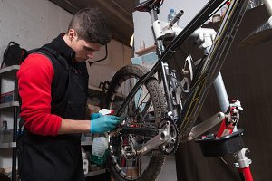 Mechanic repairing a mountain bike