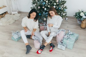 Girls opened Christmas gifts.