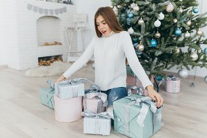 Girl unpacks Christmas gifts.