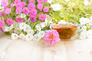 Cup of tea with flowers.