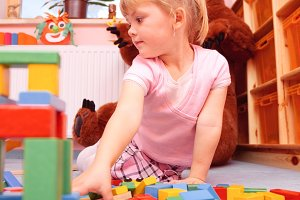 Little Girl Playing With Building Bricks