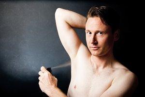 Man Putting On Deodorant