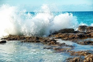 Big sea waves breaking on coast