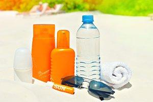 Sun protection cream on palm beach