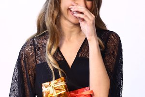 teen girl with christmas present close up photo laughing smirk