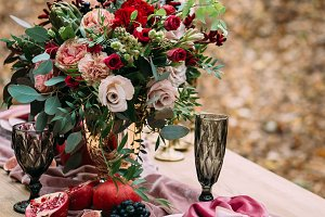 Rustic wedding decoration for festive table with beautiful flower composition. Autumn wedding. Artwork