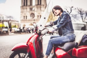 Young Chinese Female On Scooter In Paris