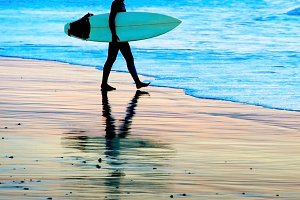 Young woman with surfboard