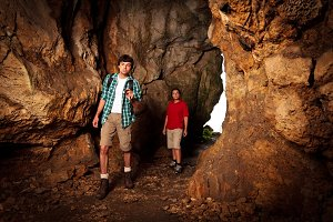 Young Couple Exploring A Cave