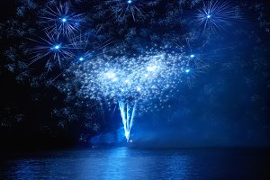 Holiday fireworks above water