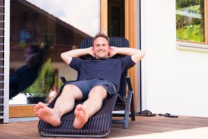Adult Man Relaxing On Patio