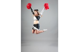 Cheerleader Jumping In Studio