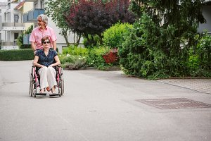 Senior Couple In Wheelchair