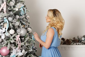 Girl next to Christmas tree