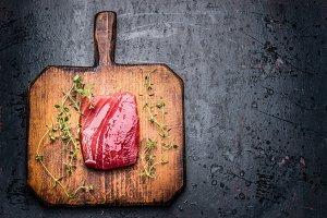 Tuna steak on wooden cutting board