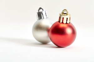 red and silver  christmas bauble on a white