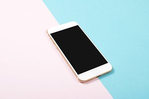 Smartphone on pink and blue background. Technology
