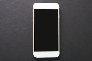 Top view of smartphone on black background. Technology