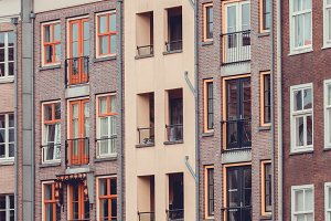 View of beautiful medieval houses in Amsterdam, Netherlands, Europe.
