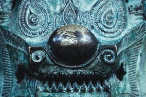 Lion Singha like one of symbol of Asian culture. The blue old metal statue, close-up.
