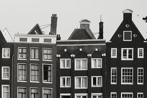 Black and white photo of beautiful medieval houses in Amsterdam, Netherlands, Europe.