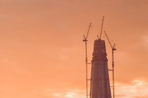 Construction of the skyscraper against the sky at sunset. Copy space.
