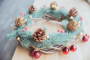 Decorative conifer wreath with cones