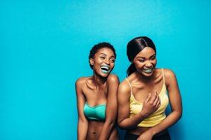 Cheerful women standing