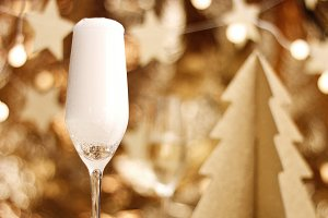 Champagne poured into a glass with Christmas decorations