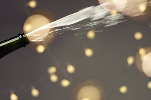Opening a bottle of champagne