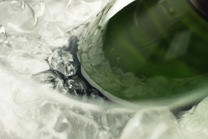 Taking a bottle of sparkling wine from ice