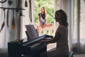 Beautiful woman playing piano