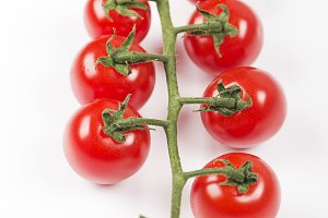 Tomatoes on white background. Isolated. Food. Vertical shoot.