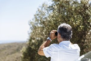 Man watching with binoculars