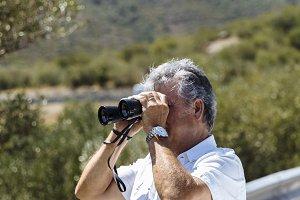 Man watching with binoculars