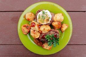 Tenderloin steaks with fried eggs