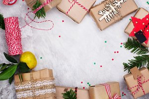 Many Christmas gifts on stone background. Top view