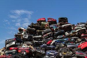 Stacked cars at a junkyard.