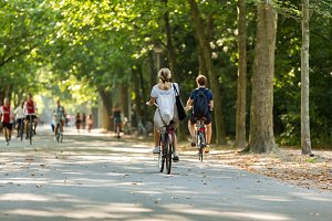Girl and boy biking in Vondelpark.