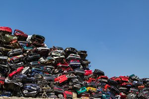 Stacked and crushed cars junkyard.