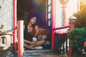 Black girl sitting inside of pagoda