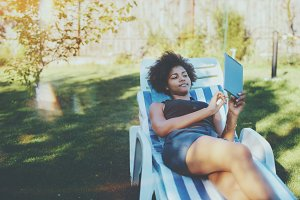 Afro girl chilling in park