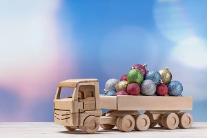 Toy wooden car with christmas balls