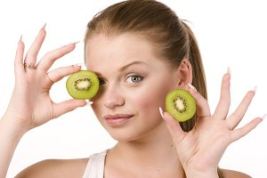 woman and slices of kiwi