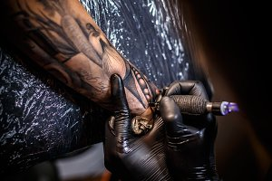 Artist making tattoo