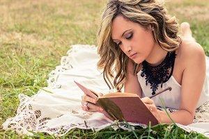 Romantic girl writing in a diary