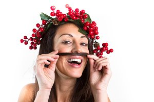 Smiling woman with a christmas wreat
