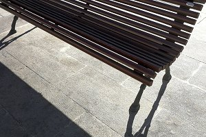 Street bench and its shadow